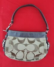 Coach no. B1094-F41856 purse with purple liner very nice