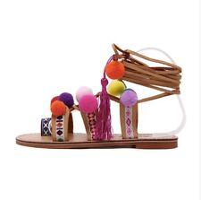 Bohemian women ladies sandals with fun lace up pompoms. modern details.