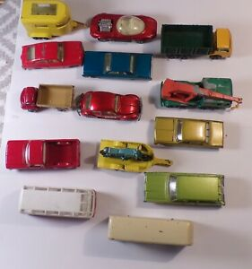 A grouping of 14 vintage Lesney matchbox cars and trucks