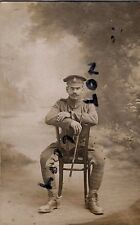 WW1 soldier Private AVC Army Veterinary Corps astride chair in France