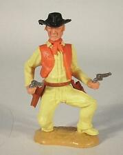 Timpo Toys Cowboy 3 Vers kniend m 2 Colts Hemd hellgelb mit roter Weste
