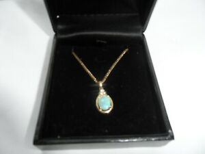 9ct gold opal and diamond pendant with 9ct gold chain.
