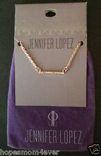 NEW - Jennifer Lopez Rose Gold Tone Crystal Bar Necklace w/ purple jewelry bag