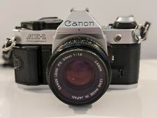 Canon AE-1 Program 35mm SLR Camera with 50mm f/1.8 FD Lens and filters