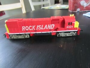h o trains: A very good running TYCO  ROCK ISLAND road diesel--it will need rail