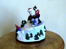 Santa Claus Is Skiing With A Squirrel On One Ski To Town Music Box