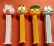 Lot of  4 Garfield PEZ Dispensers  Arlene, Garfield, Garfield w/Hat, Nermel 4.9