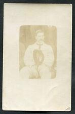 C1910 Photo Card: Man Sitting