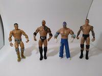 WWE Wrestling Action Figure Lot Of 4 Mattel Jakks Pacific The Rock 2011 2005