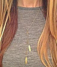 Idée cadeau bijou fantaisie , collier chaine dorée , double plumes