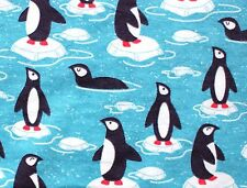 """PENQUINS ON ICE ON DARK TURQUOISE BACKGROUND FLANNEL MATERIAL 2 YDS 44 X 72"""""""