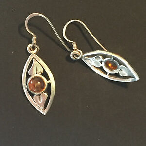 A0934 Pair of round cut amber drop earrings