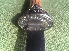 Unusual dagger. Wood grain handle and scabbard. Elegant metal work. 1foot Tl.