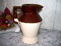 BROWN AND CREAM STONEWARE PITCHER USA