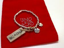 "NWT Uno de 50 Silvertone Silver Plated Stretch Bead Bracelet w/ Charm ""Salud"""