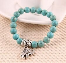 TURQUOISE BEADED BRACELET WITH TIBETAN SILVER PLATED ELEPHANT CHARM