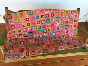 """Vintage Granny Square Afghan in Rainbow colors on Dusty pink background 40"""" x 60"""