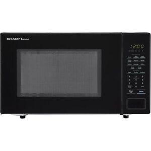 Sharp Carousel 1.1 cu. ft. Countertop Microwave in Black