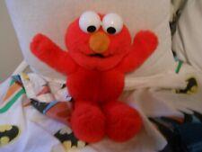 Sesame Street Elmo Plush Doll - sings ABCs when tummy pressed