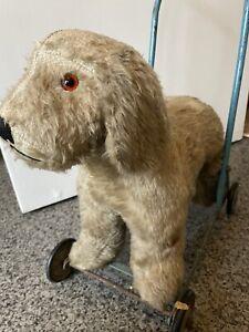 Antique vintage   1950s dog on wheels - push along toy dog