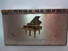 vintage 1950's Volupte goldtone music box compact and cigarette case