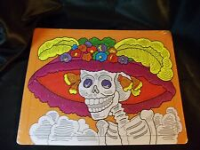 day of the dead puzzle,14x11,24 piece puzzle,picture of a skeleton wearing a hat