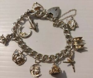 VINTAGE SOLID SILVER CHARM BRACELET And 10  CHARMS 47g