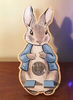 Peter Rabbit coloured 50p coin Mobile phone wooden stand. Beatrix Potters Tales.