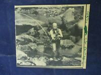 1980 President Jimmy Carter fly fishing in river Wire Press Photo
