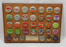 "Wooden Plaque of 34 Unused Bottle Caps 11"" X 8"" Coca cola Sprite Crush Fanta"