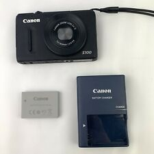 Canon PowerShot S100 Digital Camera (Black) with Charger And Battery