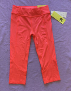 All in Motion Girls' Laser Cut Capri Leggings with Pockets Coral