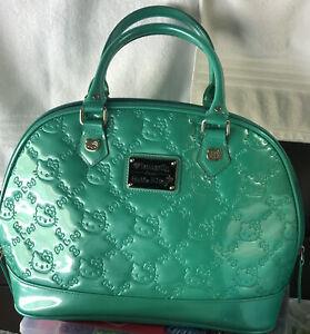 Loungefly loves hello kitty black handbag 34114 16'' by 10''