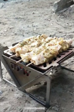 Portable camping / tailgating charcoal grill.  OPW