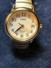 Vintage Timex Indiglo watch with gold tone stainless steel elastic band