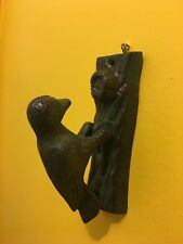 Cast iron woodpecker bird door knocker