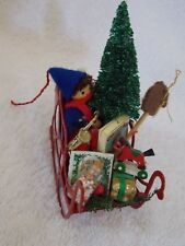 Vintage Sleigh With Child, Toys, Trees In It Christmas Ornament