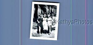 FOUND B&W PHOTO N_9355 PRETTY WOMEN IN DRESSES POSED BY TREE