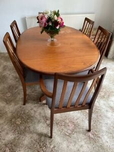 G Plan oval extendable teak dining table, 6 chairs a sideboard & drinks cabinet