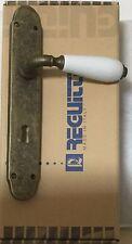 Maniglia Reguitti Cinzia 069 bronzo anti porcellana bianca su placca foro patent