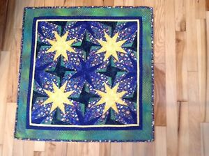 """Exciting hand made wall quilt 29.5"""" x 29.5"""" in green and yellow stars."""