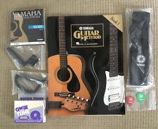 Yamaha Folk Guitar - Hal Leonard Method Book 1; Qwik Tuner; 80/20 Strings; Strap