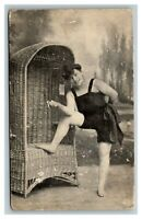 Vintage 1900's Photo Postcard Woman Smoking in Bathing Suit Wicker Chair - ODD