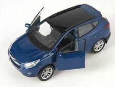 Blitz envío hyundai tucson ix azul/Blue Welly modelo auto 1:34 nuevo & OVP