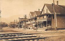 Groveton NH Street View Storefronts McNally's Store Train Tracks RPPC Postcard
