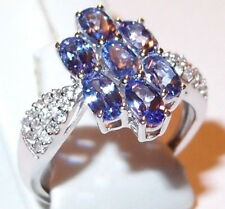7-stone Tanzanite (1.80ct) ring with Zircon shoulders in 9k White Gold. Size L.