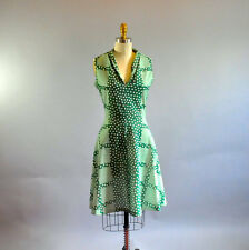 1970s Green Polka Dots Sleeveless Swing Dress. Plaid Polka Dot Mid Length Dress.