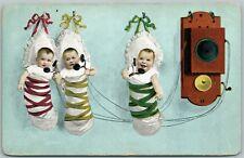 MULTIPLE BABIES PHONE TALK ANTIQUE POSTCARD TELEPHONE PIONEERS OF AMERICA