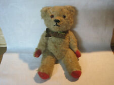 New ListingAntique vintage straw stuffed teddy bear, jointed limbs glass eyes red felt pads
