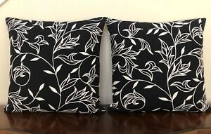 New, Pair of Designer Black Throw Pillows with White Floral Embroidery.